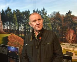 Passchendaele exhibition touring curator Freddy Declerck in front of a photograph of the Buttes...