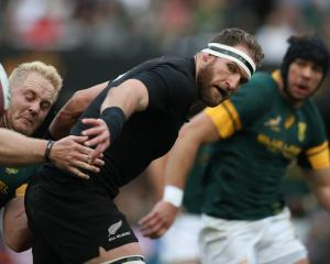 All Black captain Kieran Read offloads in the tackle during last years thumping victory over the...