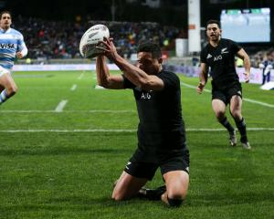 Anton Lienert-Brown of New Zealand scores a try during The Rugby Championship match between the...