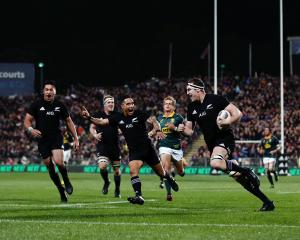 Brodie Retallick runs in a try during the Rugby Championship match between the All Blacks and the...