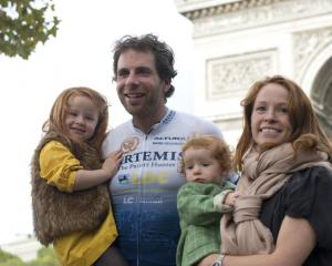 Mark Beaumont poses with his wife and daughters in Paris after completing the bike ride. Photo:...