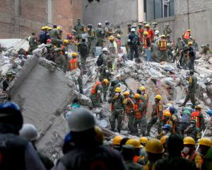 Rescue efforts continue at a residential building in Colonia Condesa, in Mexico City, after the...