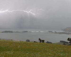 Forked lightening over Blueskin Bay. Photo: Hamish Rennie