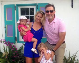 New Zealander Fiona Campbell,  her husband Justin and their two young daughters Rae (3) and...
