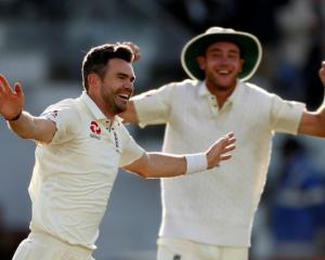 James Anderson celebrates the wicket of West Indies' Kraigg Brathwaite and his 500th test wicket....