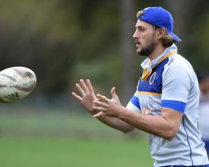 Otago lock Josh Furno looks to catch the ball at a training at Logan Park this week. Photo:...