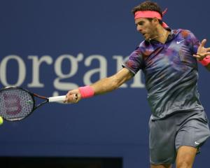 Juan Martin Del Potro plays a forehand against Roger Federer in yesterday's US Open quarterfinal....