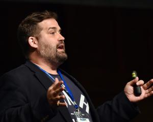 United States Government emerging citizen technology leader Justin Herman speaks to an audience...