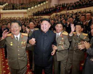 North Korean leader Kim Jong Un reacts during a celebration for nuclear scientists and engineers...