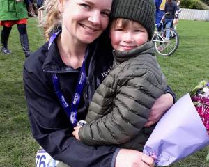 Cancer survivor Kirsty Wing (35) with her son, Gregor, after completing the Dunedin half marathon...