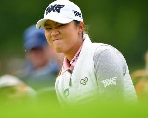 Lydia Ko of New Zealand reacts to a putt during the final round of The Evian Championship at...