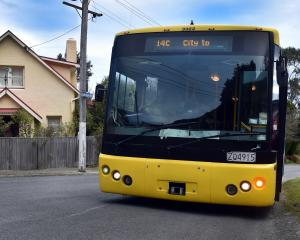 Owain Morris alights from the last Ravensbourne bus on the corner of Junction Rd and Taupo St...
