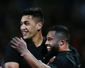 Lima Sopoaga of the All Blacks celebrates with teammate Rieko Ioane after scoring a try during...