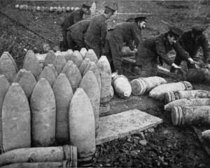 A never-ending supply of ammunition: loading shells on a trolley, to be taken to the guns at the...