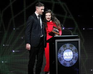 Lorde and Joel Little accept the APRA Silver Scroll Award for their song Royals.  (Photo by Fiona...
