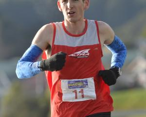 Wellington runner Sam McCutcheon on his way to winning the Dunedin marathon yesterday. Photo:...