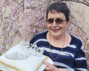 Alexandra Blossom Festival princess convener Dianne Elliot displays the range of royal headgear...
