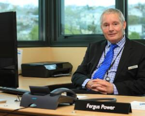 Waitaki District Council chief executive Fergus Power settles in to his new office on his first...