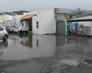 Surface flooding caused by a blocked drain outside John's Furniture Warehouse in Ribble St,...