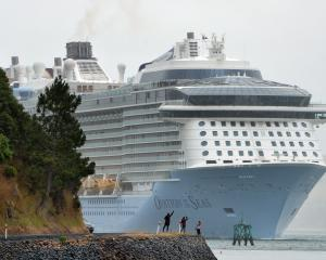 The giant cruise ship Ovation of the Seas approaches Port Chalmers on its visit to Dunedin in...