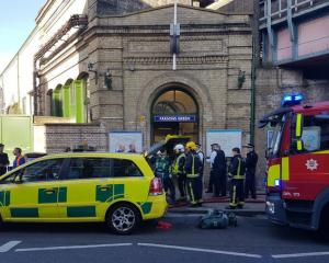 Emergency services attend the scene following a blast on an underground train at Parsons Green...