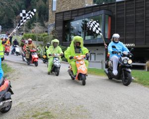 Participants in the scooter charity ride arrive at the Queenstown Rec Grounds on Saturday. Photo:...