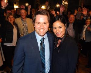 Clutha-Southland's newly-elected National MP Hamish Walker and  partner Penny Tipu celebrate with...