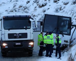 The scene of a crashed Go Orange charter bus on The Remarkables ski area access road today. PHOTO...