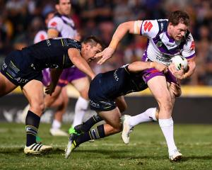 Timothy Glasby of the Storm makes a break during the match between the North Queensland Cowboys...