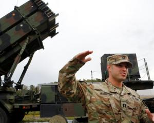 US captain Thomas Harris gestures during the joint Nato exercise 'Aurora 17' at Save airfield in...