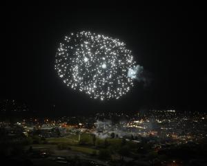Smoke drifts across Alexandra during last night's Mardi Gras fireworks display. Photo: Gregor...