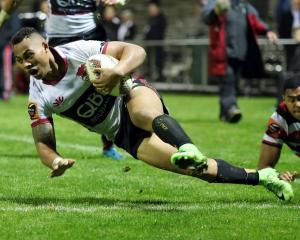 Tevita Li scores his late try for North Harbour last night's win over Counties-Manukau. Photo:...