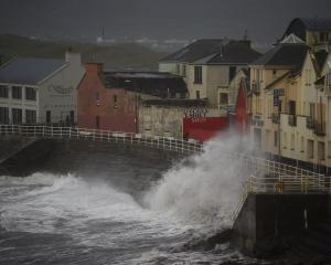 Waves slam the coast as the storm hits the County Clare town of Lahinch in Ireland. Photo Reuters