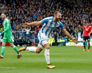 Huddersfield's Laurent Depoitre celebrates scoring their second goal. Photo Reuters