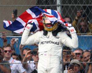 Lewis Hamilton celebrates his Formula One World Championship victory. Photo: Reuters