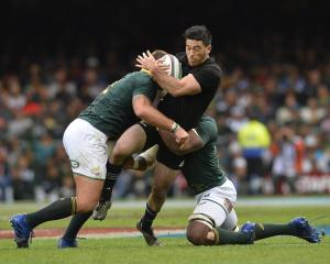 Nehe Milner-Skudder gets tackled in the match between South Africa and New Zealand in Cape Town....