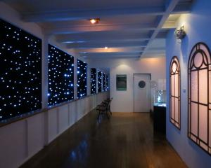 The recreated Titanic promenade deck includes a depiction of the starry night, the same night an...