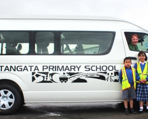 Kaitangata Primary School pupils (from left) Martin (5), Jess (7) and Freddy Daumann (8) with...