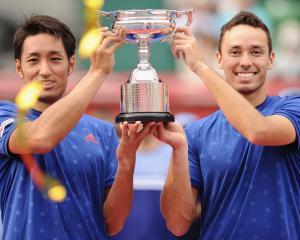 Yasutaka Uchiyama and Ben McLachlan hold the trophy for winning the Japan Open in Tokyo. Photo:...