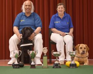 Blind indoor bowlers Nooapii Rouvi, and his guide dog, Byron, and Lynn Keogh and her guide dog,...
