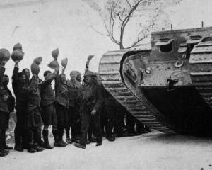 The latest form of destruction on the Western Front. Soldiers cheer the return of a tank from its...