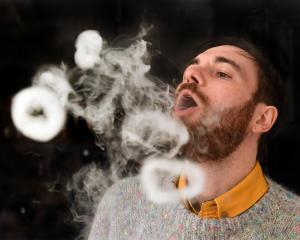 Dunedin e-cigarette store Vapourium account manager Cody Peneamene blows vapour rings from a...
