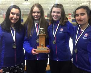 The successful Kavanagh College curling team of (from left) Temika Bishop, Emily Armstrong,...