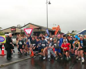The 108 Kelly's Canter runners set off from the Palmerston railway station for the 4km run to the...