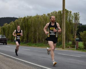 Stafford Thompson breaks away from early leader Brad Trebilcock during the Otago Half-marathon...