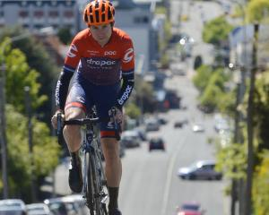 Otago cyclist Brad Evans humps his way up High St in Dunedin earlier this week. The 25-year-old...