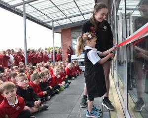 One of Fairfield School oldest pupils, Mikayla Preston and the school's youngest, Calla Weir, cut...