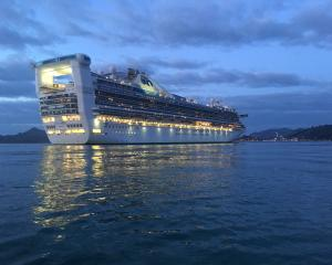 The  Golden Princess makes its way into Port Chalmers this morning. Photo: Stephen Jaquiery