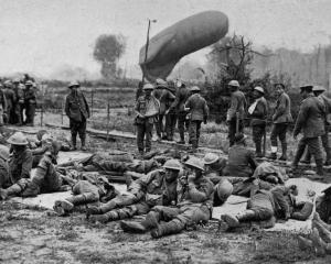 A scene at the rear of the trenches in the battle of Flanders, showing the first batch of wounded...