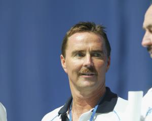 Former Australian Olympic swim coach Scott Volkers, pictured here in 2003, has been charged with...